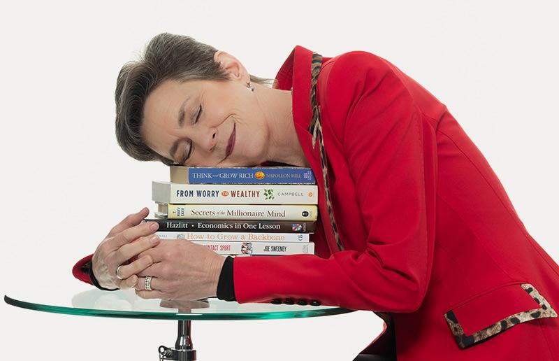 Meg holding books